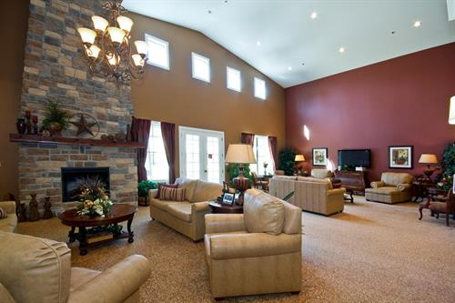 Enjoy a cup of coffee and relax by the fire in one of Heritage Oaks' spacious common areas