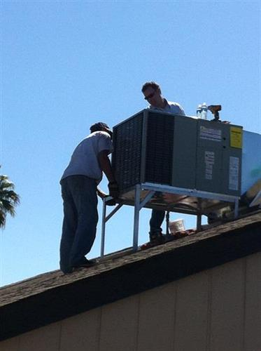 Jimmy and Matt on the roof, installing.