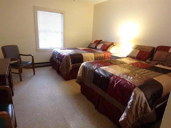 Lodge room (9), 2 full-size beds, private bath, 5 other rooms with 2 twin beds shred bath, kitchen and large meeting space