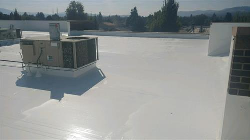 A Liquid Applied Silicone roof with foam repairs