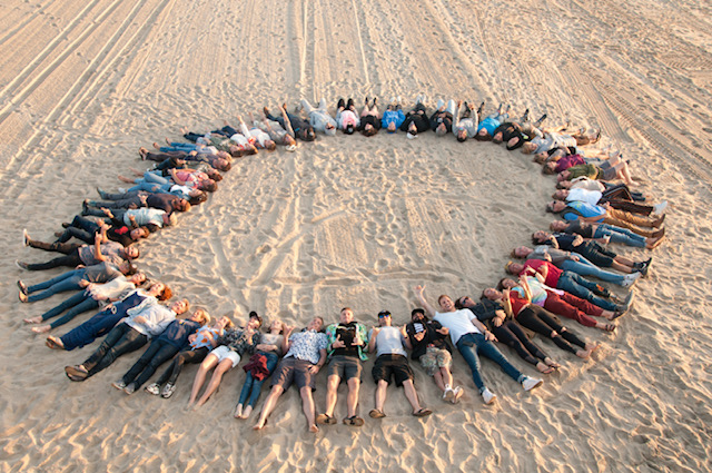 Circling up on the beach after our workshop November 2019