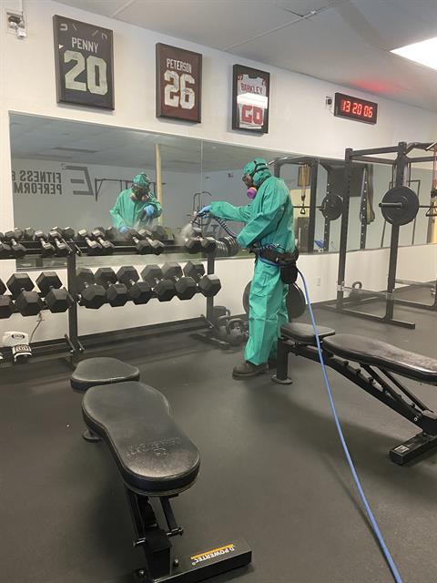Disinfection tech servicing a private gym that trains NFL athletes.