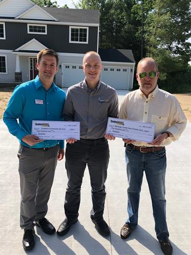 Sable Homes General Manager Bryan Burnham (center) presents a combined $1,000 in donations to TrueNorth Community Services and Newaygo County Area Promise Zone from its first two home sales in Newaygo's River Hills neighborhood. Pictured left to right: Mark Kraus, TrueNorth development director; Bryan Burnham, Sable Homes general manager; and Mark Guzniczak, Promise Zone Authority board member.