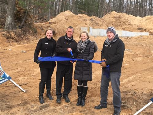 Sable Homes representatives Karin Kay, Ron Austin, Angie Hall and Bryan Burnham kick off a revitalization project in Newaygo's River Hills neighborhood.