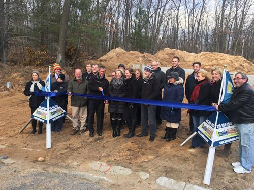 Representatives from Sable Homes, TrueNorth Community Services, Newaygo County Area Promise Zone and River Country Chamber of Commerce of Newaygo County kick off a revitalization project in Newaygo's River Hills neighborhood.