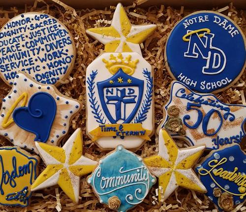 "Gourmet Decorated Cookies ""Notre Dame 50th Anniversary"" Incorporating the mission, core values and logo elements"