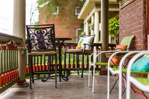 Watch the world go by from our wrap-around porch!