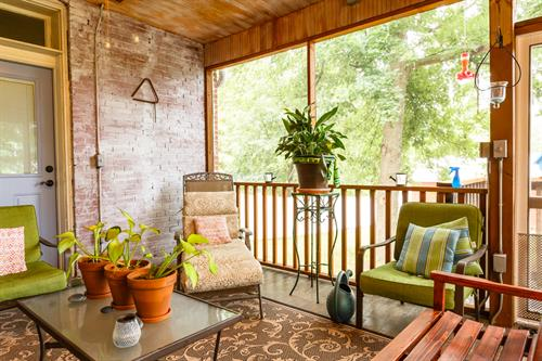Rest easy on the peaceful screened back porch!