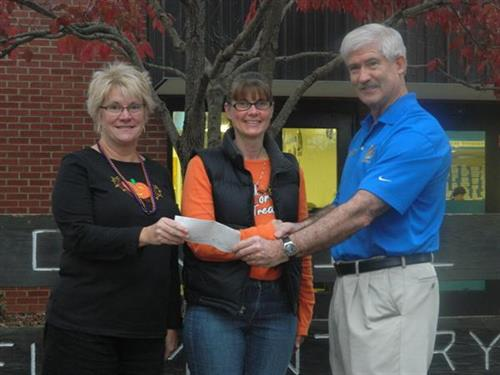 Receiving money raised by Oak Hill Elementary School for wheelchairs