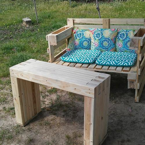 Another favorite, the loveseat and bench/tablle.  The seat is made from pallets, the bench is made from 2x4s and is super strong.  You can use it eithr as a table or for extra seating for guests.