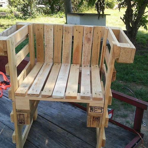 Chairs with built in cup holders on each arm.  Will hold multiple items.