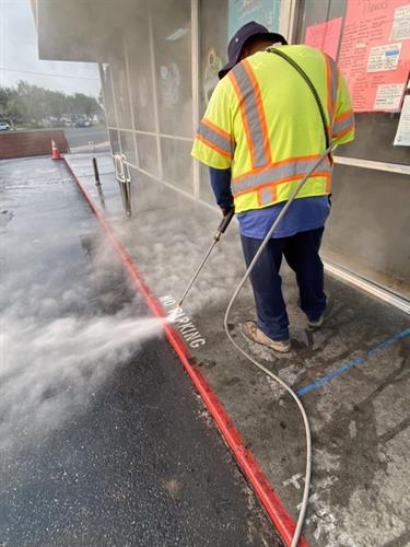 Using steam to deep clean sidewalks out front a commercial property for their guest and their employees