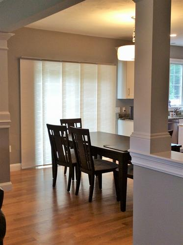 Sleek, sophisticated panel track blinds work great on sliders.