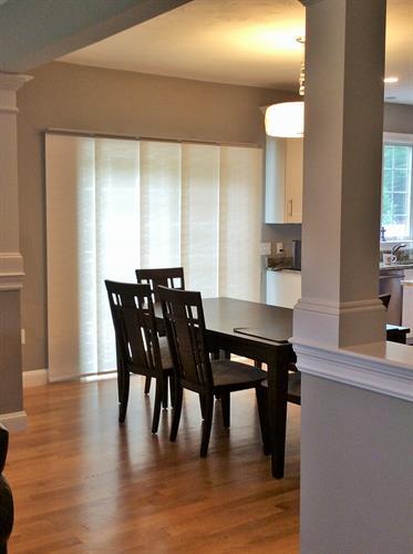 Sleek, sophisticated panel track blinds work great on sliders.