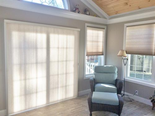 Another alternative to vertical blinds- Honeycomb shades are energy efficient and easily slide on a top rail.