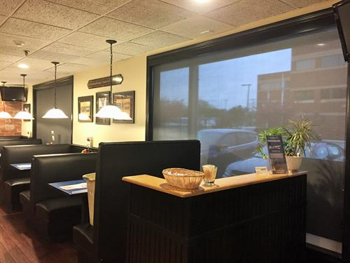 The Alumni restaurant updates their window shades to help customers feel comfortable.