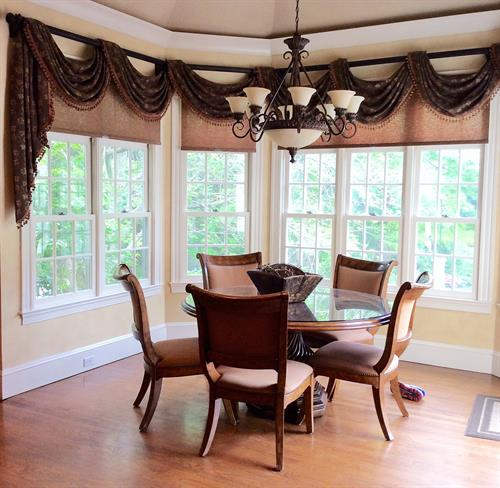 Roller shades in natural looking fabric saved this family's too -sunny breakfast!