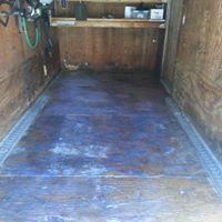 Original picture of landscapers trailer made slippery by constant oil/grease spills