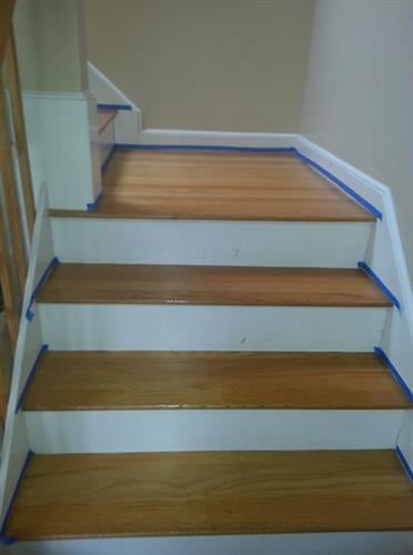 Hardwood stairs treated because family dog was slipping down them