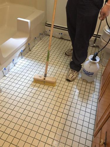 Bathroom floor being treated