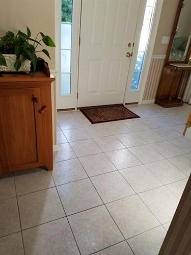 High gloss, very slippery, tile foyer made slip resistant without losing its shine