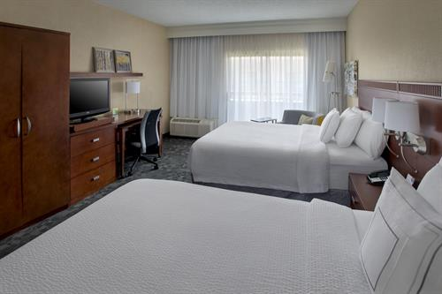 Each of our newly renovated guest rooms feature modern decor and offer one king, two doubles or two queen beds, all with thicker, more comfortable mattresses, rich linens and fluffier pillows.
