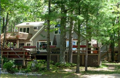 The back of the lodge with deck looking out to Lake Dubbonnet
