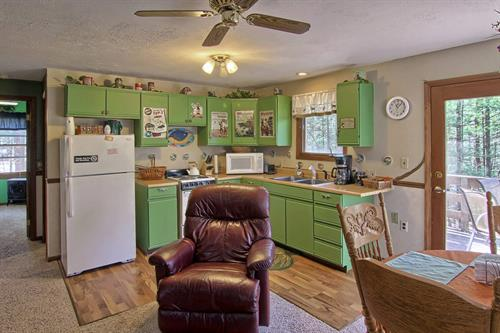 The two bedroom Pines Nature Suite features a full kitchen and private deck with gas grill