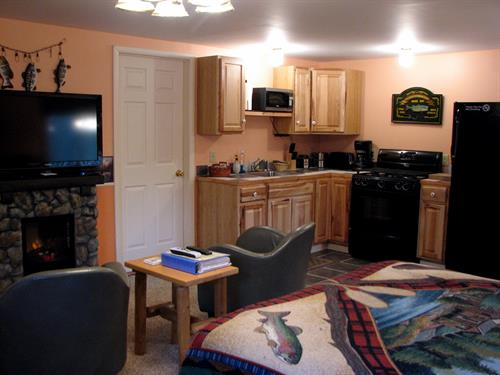Angler's Nook has a features a full kitchen and along with a gas grill on the private deck