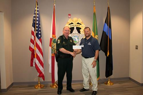 Presenting a grant to the Flagler County Sherriff's Office