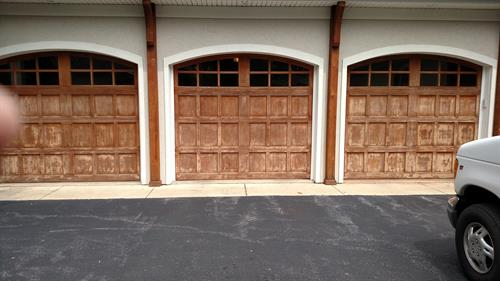 oak garage doors stripped to bare wood