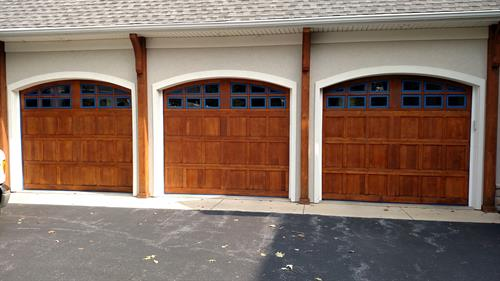 oak garage doors refinished