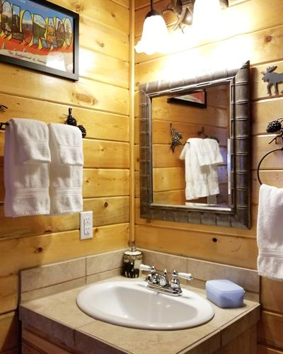 Private bathrooms with fresh, clean linens, many amenities, and shower