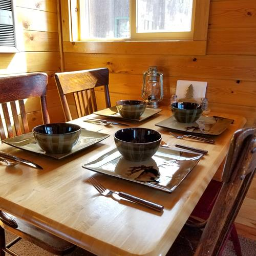 Each cabin has a dining table with everything you need to enjoy a your meal!