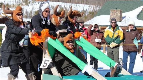 Anthony Melchiorri and Blanche Garcia of Travel Channel's Hotel Impossible participate in bed sled races at Grand Lake's Annual Winter Carnival
