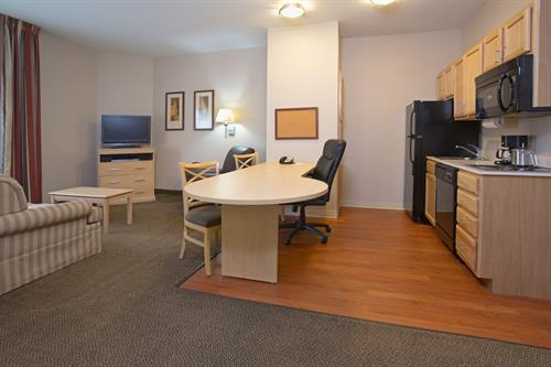 Suites feature living area, kitchenette, bedroom and bathrooms.