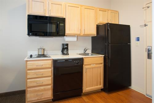 Each suite features a full kitchenette
