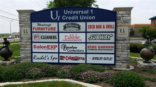 The U1 monument sign holds other businesses signs in the plaza and they can be changed.