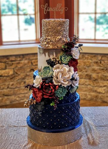 Jewel toned wedding cake with sugar flowers