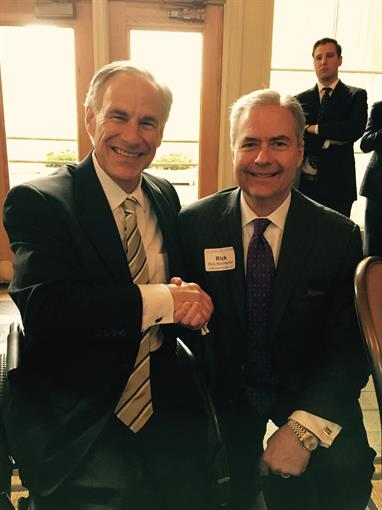 Managing Principal Rick Baumeister with TX Governor Greg Abbott