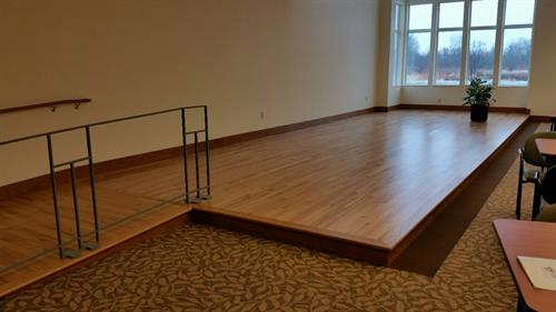 Brin Hall stage for entertainment and programs that we offer to our residents, families and guests.