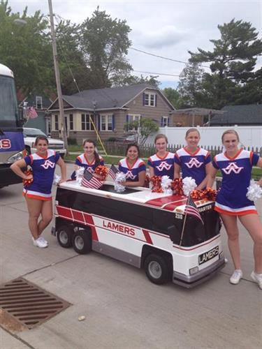 Lamers Bus Lines' motor coach go-cart at the 2013 Appleton Flag Day Parade with the Appleton West High School Cheerleaders