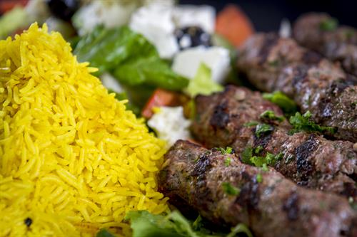beef kofta kebab plate with rice and Greek salad