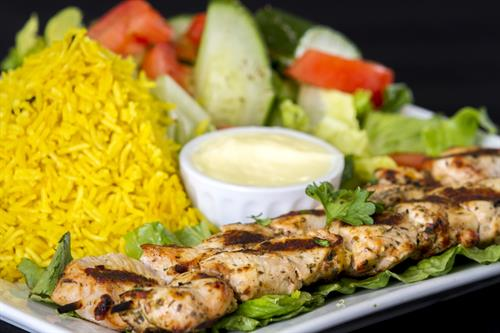 Shish kebab plate with rice and garden salad