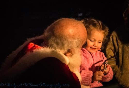 Little girl on Santas lap, Holiday Tree Lighting 2017
