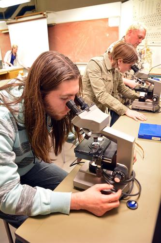RCC Student looking down the microscope.