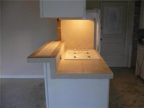 We can build all sorts of kitchen countertops: butcher block, tile, granite, marble, concrete, Silestone.