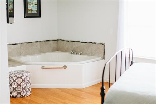 Beautiful black iron bed oversized waterbirth tub in Eydis Suite