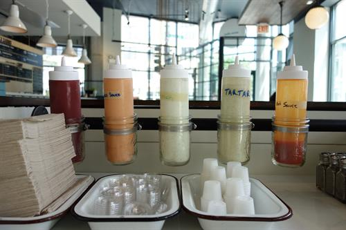 Choose your sauce to compliment your meal at our serve yourself sauce bar