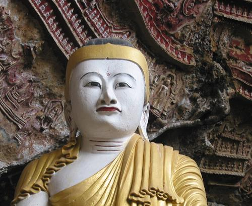 A statue of Buddha sits in a sacred cave, Burma/Myanmar